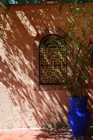 small arched window in the Jardin Majorelle, Marrakech