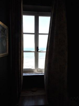 Wood framed window overlooking the Atlantic, Essaouira