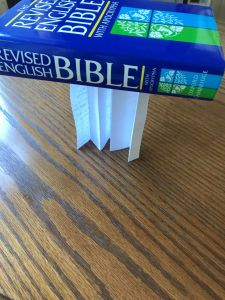 Photo of folded paper as support for book