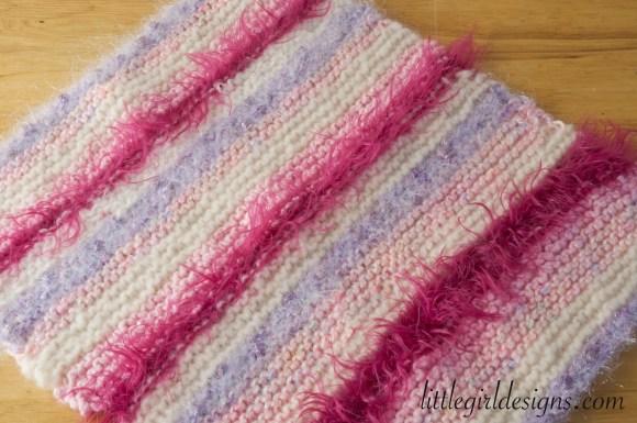 How to Knit a Baby Doll Blanket - an easy tutorial on how to knit a baby doll blanket using leftover yarn scraps. @littlegirldesigns.com