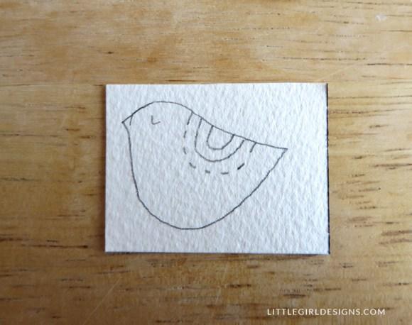 Step one in how to make a little bird bookmark @littlegirldesigns.com