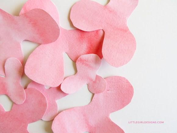 Make a watercolor flower barrette--a tutorial on how to make a little flower barrette out of watercolor paper. Includes a free template @littlegirldesigns.com.