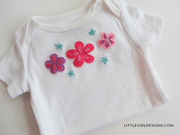 Personalized Baby Gift - Painted and embroidered baby outfit. Make a sweet baby shower gift for a new baby with my tutorial. This is such a simple project and you can completely personalize the shirt for the baby! @littlegirldesigns.com