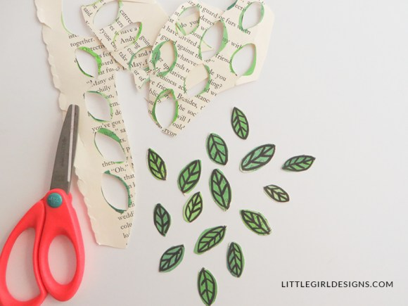 How to Make Leaves out of Book Pages: Make beautiful art out of discarded books. It's so simple to make these leaves out of old book pages, and you can use them in a myriad of ways. I'll show you how! @ littlegirldesigns.com