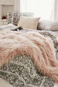 faux fur throw via urban outfitters.