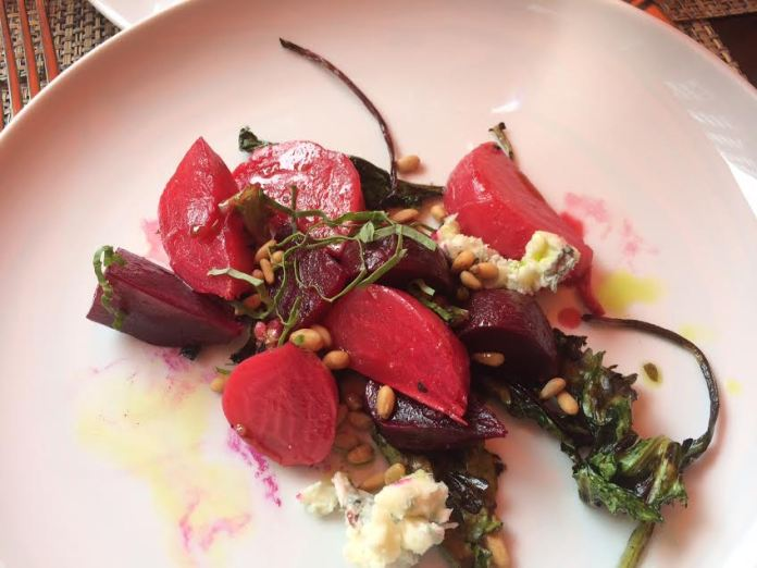 Grilled beet salad with greens, gorgonzola, and pine nuts