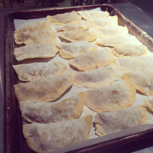 Once the pierogi is filled and sealed, it rests on a baking sheet