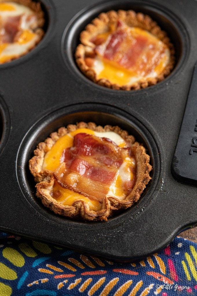 close up of bacon baked bean cheddar toast cups in muffin tray