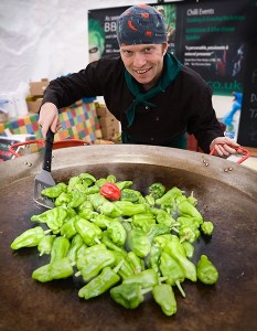 Chilli Rich from Little Green Men Chilli cooking in his giant paella chilli pan