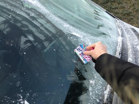 Credit Card to defrost windscreen in New Zealand winter Travel Tips Blog