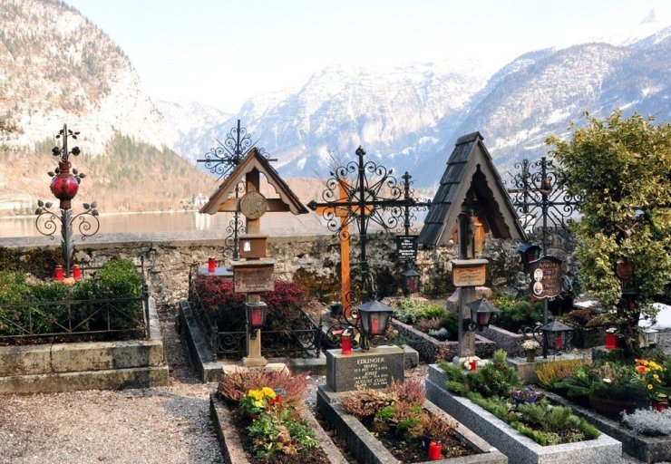 These graves in the Hallstatt cemetery grounds come with their own flower garden and a view of the lake.