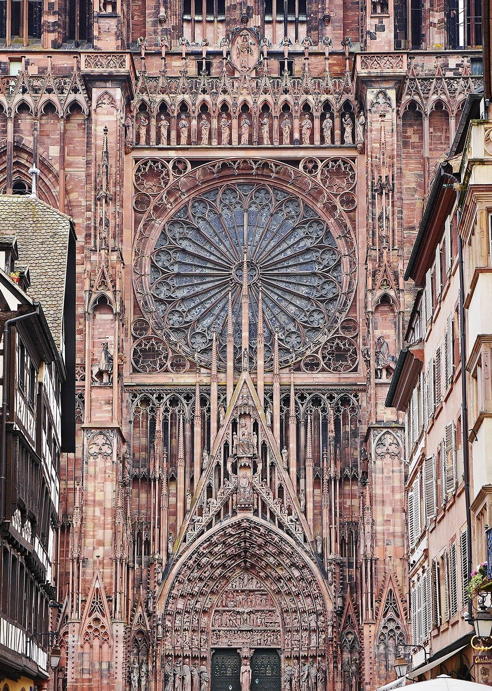Strasbourg travel guide - One of the most impressive structures built in the Middle Ages lies in the center of Strasbourg – the massive Cathedral of our Lady of Strasbourg. Admire its intricate façade and interiors and visit the astronomical clock inside – just one of the many amazing things to do in Strasbourg! Click through for a full guide.