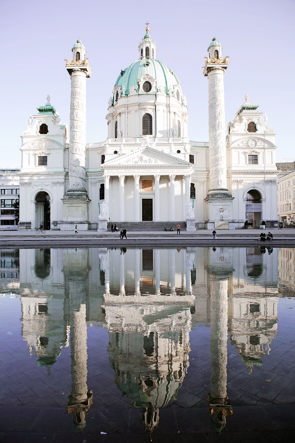 Vienna is filled to the brim with beautiful buildings from every art movement. This is Karlskirche, the city's most outstanding baroque church. Read more about the city's top historical landmarks in this essential travel guide to Vienna, Austria.