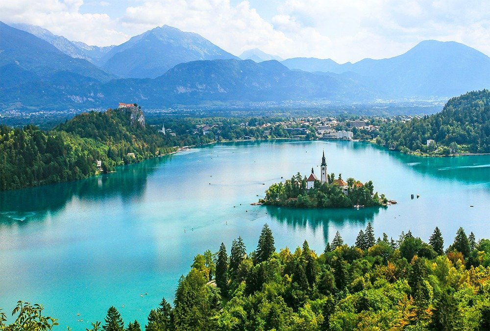 Slovenia travel guide – visit Lake Bled, one of Slovenia's most loved destinations. Enjoy the breathtaking views of the Lake Bled, go for hikes around the Triglav National Park, and explore the beautiful natural landscapes in the area. Here's what to do for 5 days in Slovenia.
