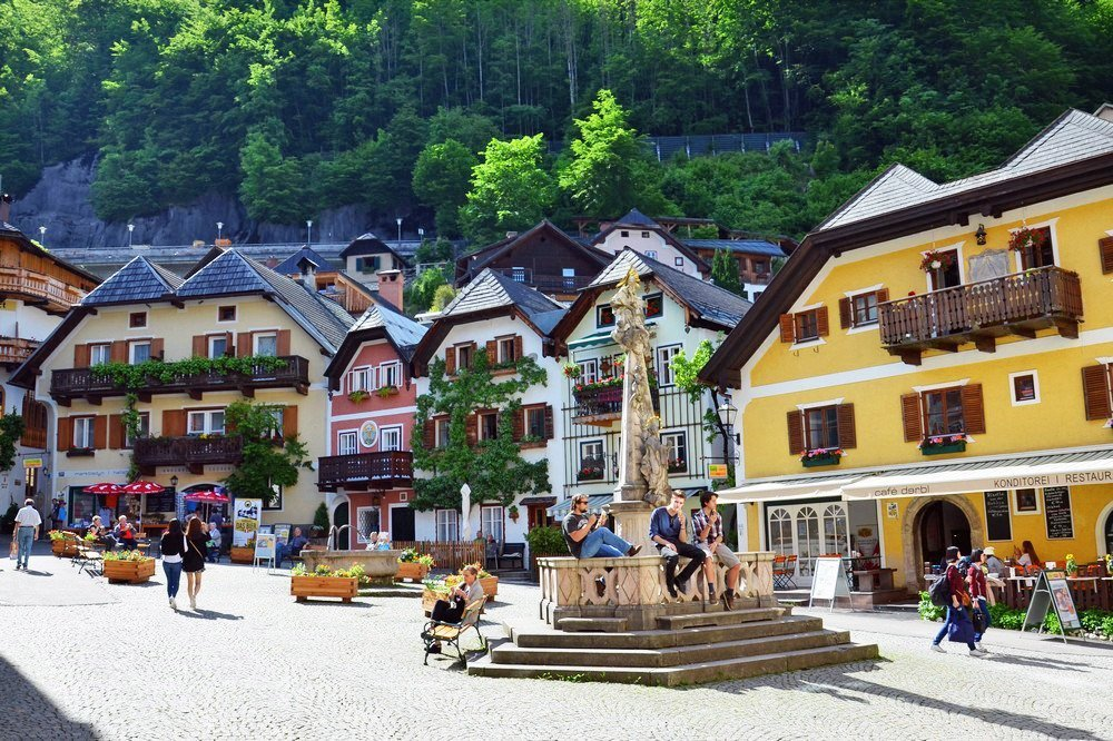 Hallstatt travel guide - Hallstatt's market square with its pretty pastel buildings brings the town's locals and visitors together.