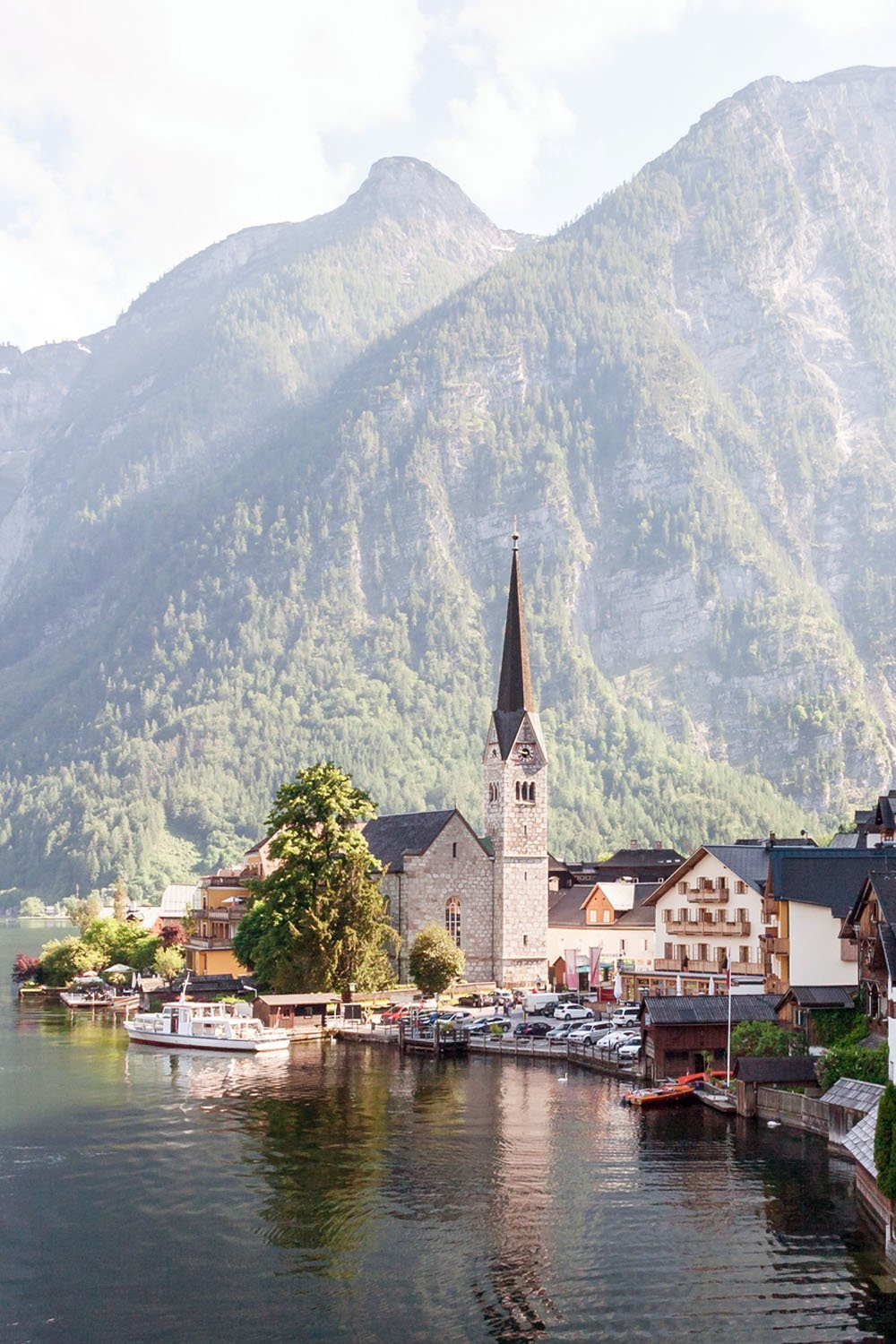 A calm blue lake mirroring the sky, mountain ranges setting a picture-perfect background, and pastel lakeside houses lending the historic town a storybook vibe - that's what to expect in Hallstatt, Austria! Here's a travel guide to Austria's most photogenic town.