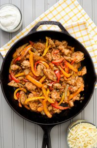 Make these delicious, veggie-packed Skillet Chicken Fajitas NOW! They'll soon be a weekly favorite! So easy and so delicious!
