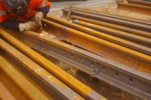 Oxy cutting the rail into lengths