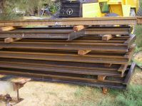 Sections of rail frame oiled ready to install on site