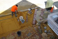 Screeding and compacting the base