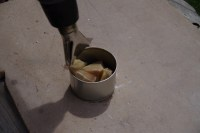 Beeswax in tin, with a heat gun