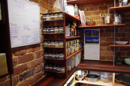 A whiteboard and an alphabetised spice rack, what more could anyone need?