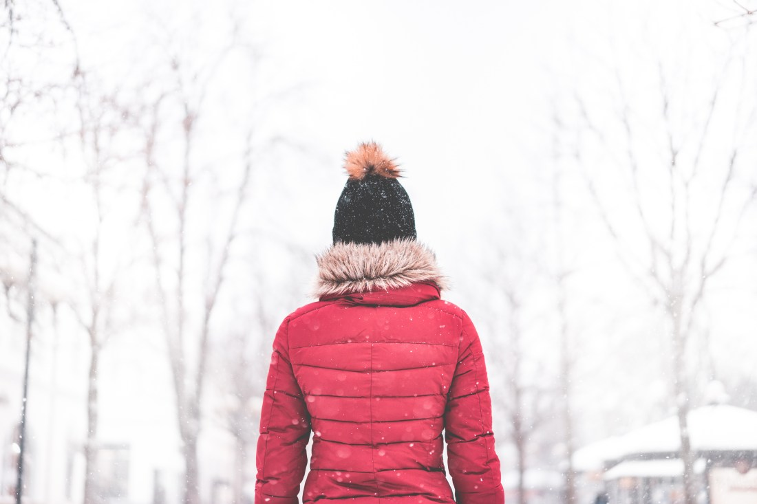 woman-standing-in-the-middle-of-the-park-in-snowy-weather-2-picjumbo-com
