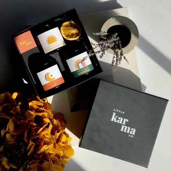 trio scented candle gift set with personalised sun moon and rainbow label designs