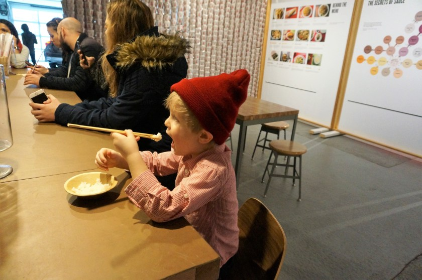 Eating yummy noodles at the CHOW Exhibit