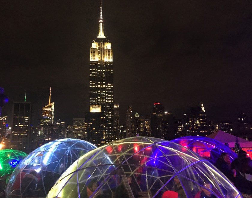 Night scene with Igloos at 230 Fifth Rooftop in NYC