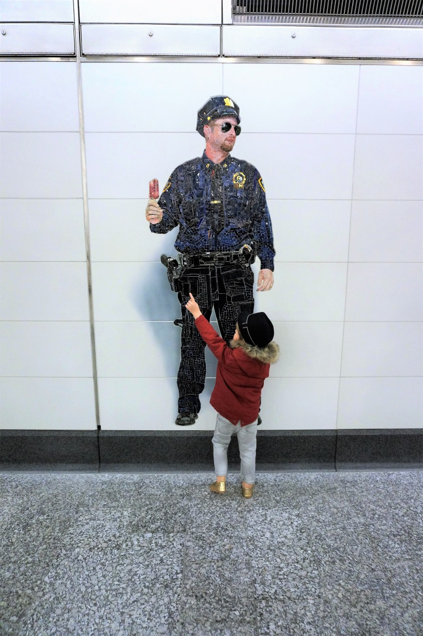 Police Officer art in Second Ave Subway by Vik Muniz