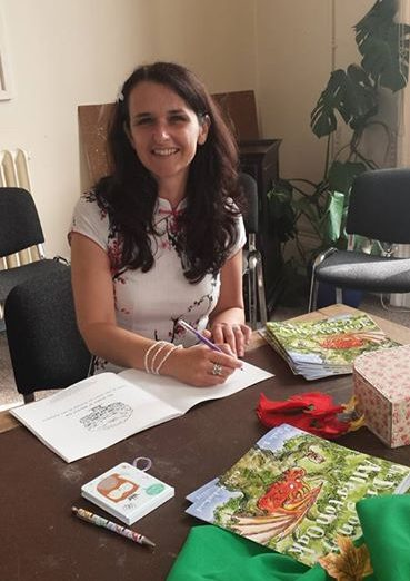 Author signs books at book launch