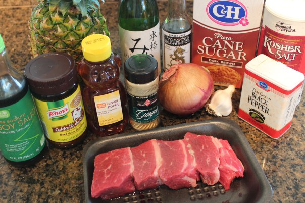 short ribs, soy sauce, beef stock, sesame oil, ginger, onion, brown sugar, cooking sake, pineapple, honey, garlic