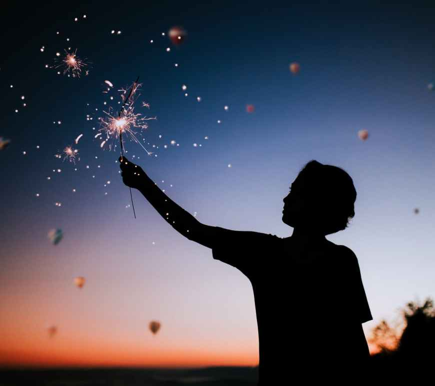 person holding sparkler silhouette