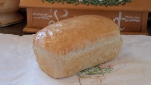 I rub the top of the bread with butter to soften it up. Yum! Nothing like homemade hot bread.