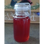 old fashioned jar of raspberry honey