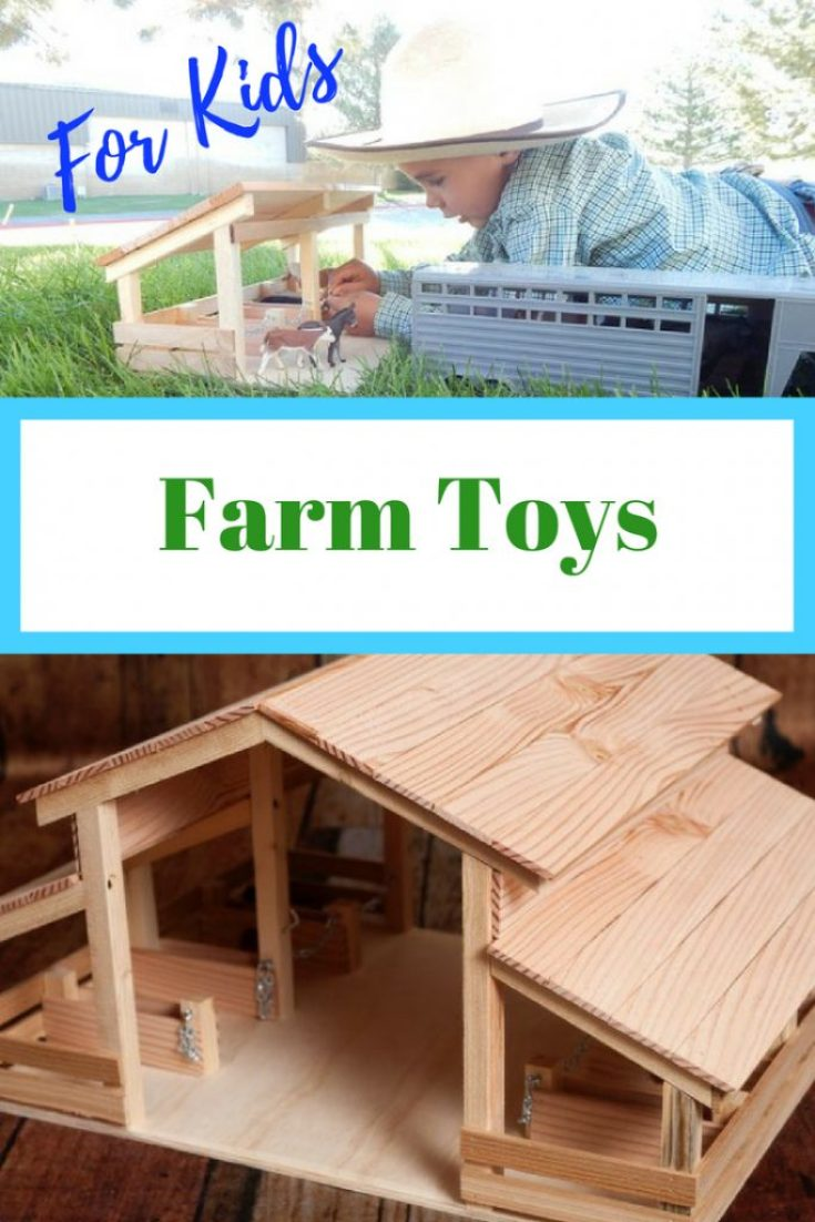 Stable made out of wood, little boy playing with a stable, horses and horse trailer