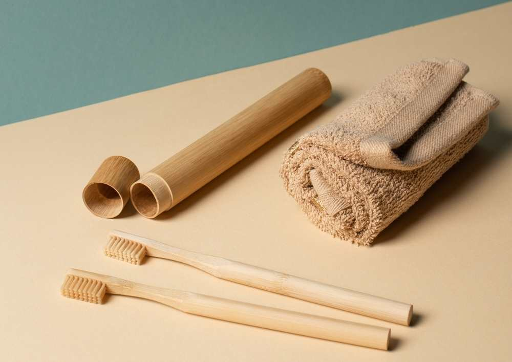Image of a toothbrush case, bamboo toothbrushes and towels.