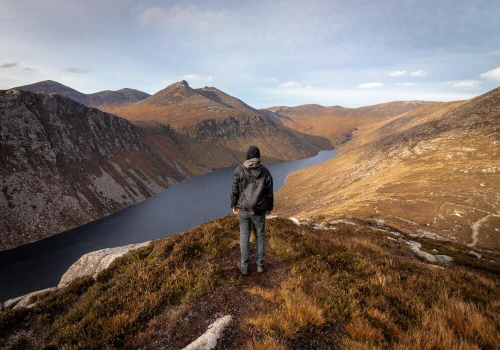 Man standing in Silent Valley Mountain Park for solo travel anxiety