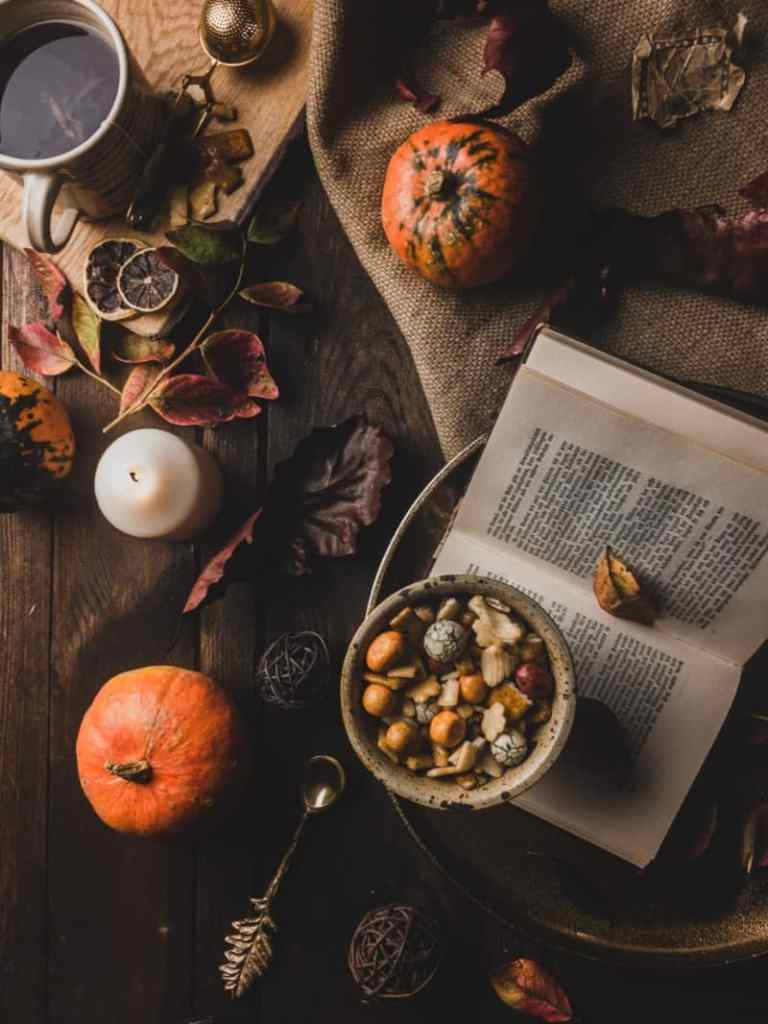 An autumn display on a table with a book and snacks