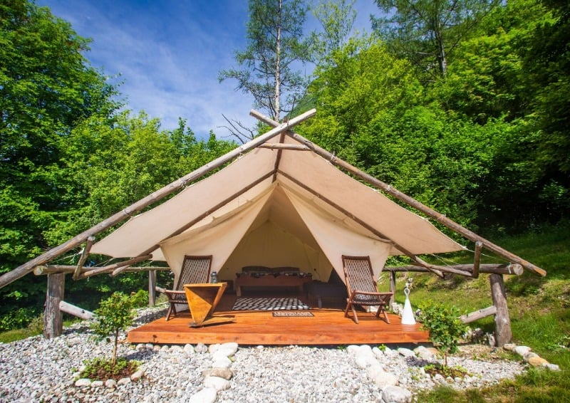 Spacious glamping tent with porch, and deckchairs