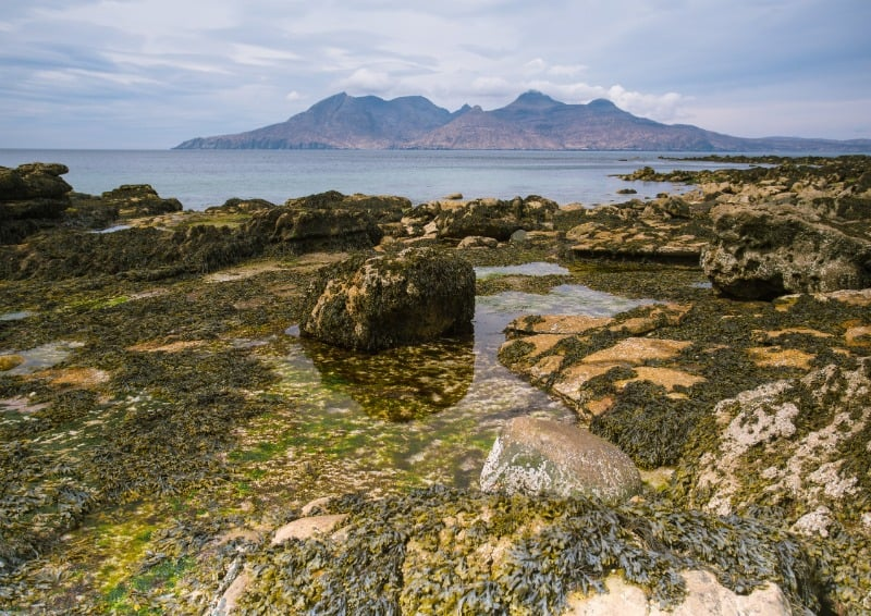 Isle of Eigg coast with a view out towards another island.