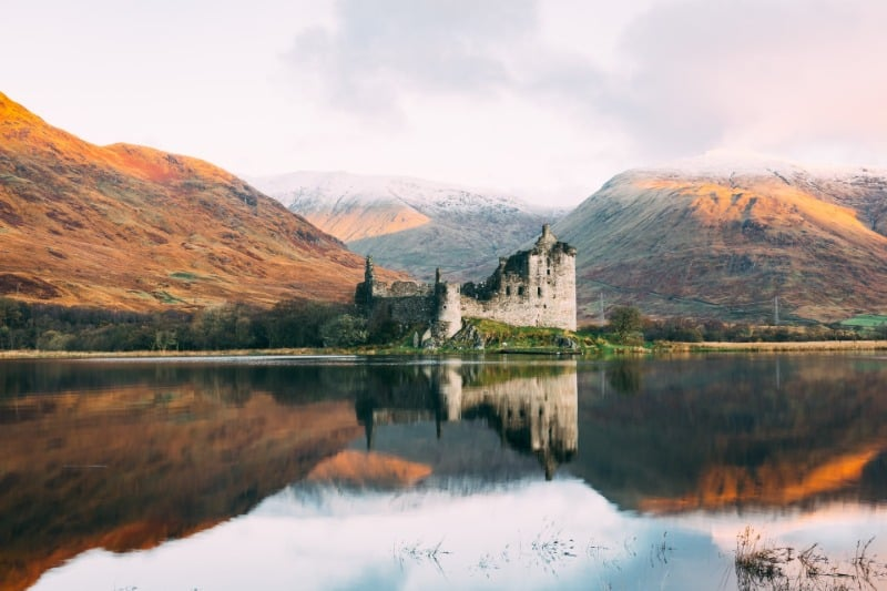 Kilchurn Castle reflected in Loch Awe. It's a must for your Scottish Highlands itinerary.