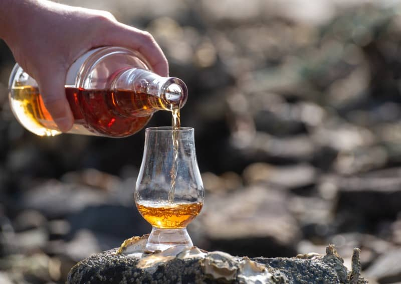 Islay Scotch whisky pouring into a glass