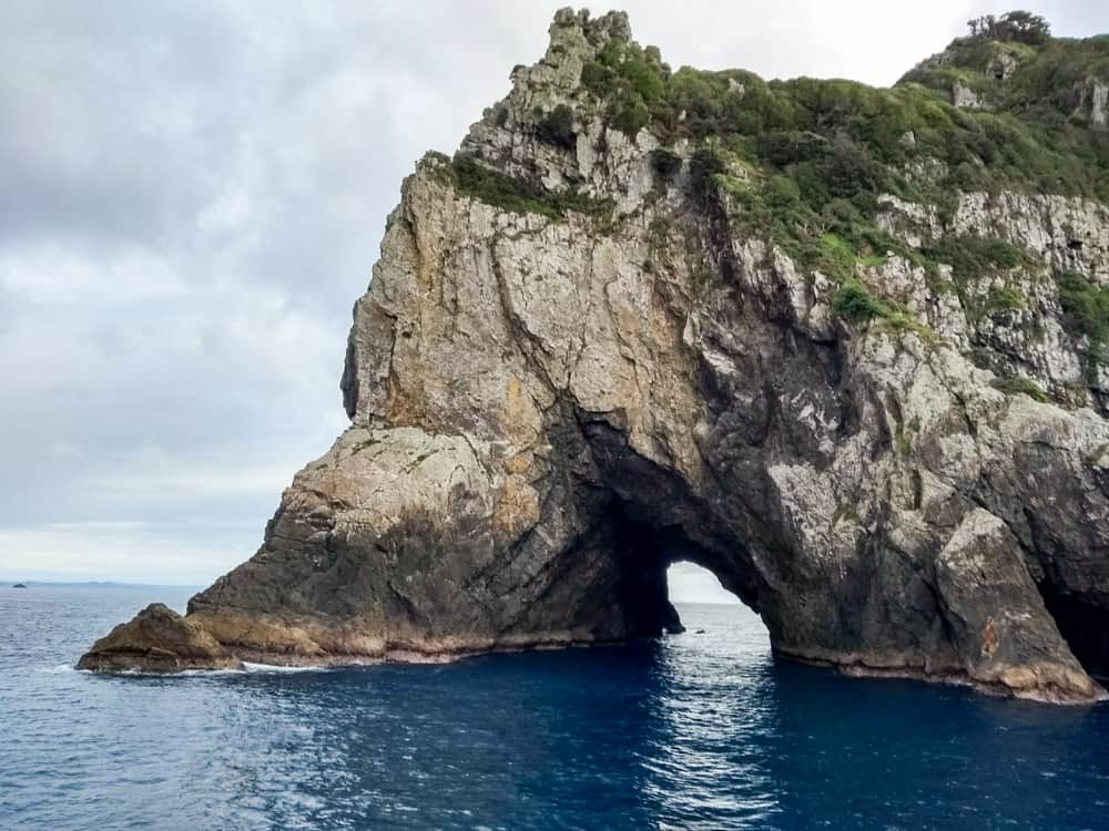 The Hole in the Rock in the Bay of Islands. Sometimes catamarans pass through it.