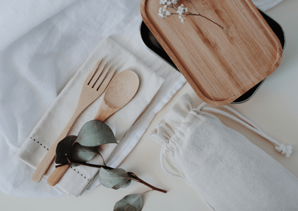 Bamboo cutlery and napkins with white linen.