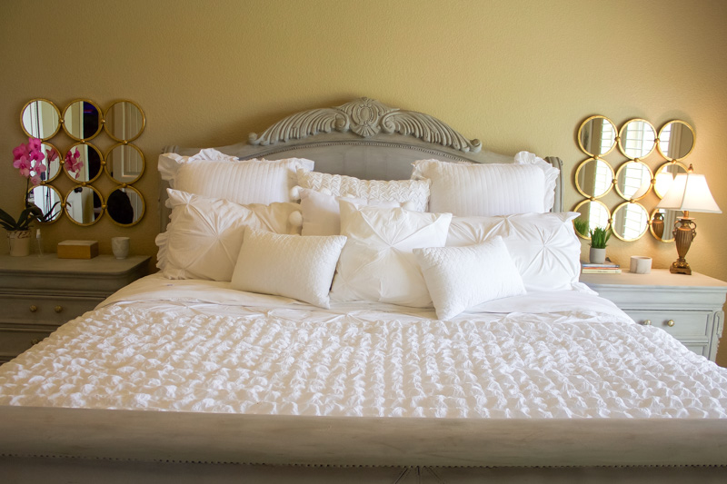 a crisp and clean master bedroom makeover white and gold with grey furniture