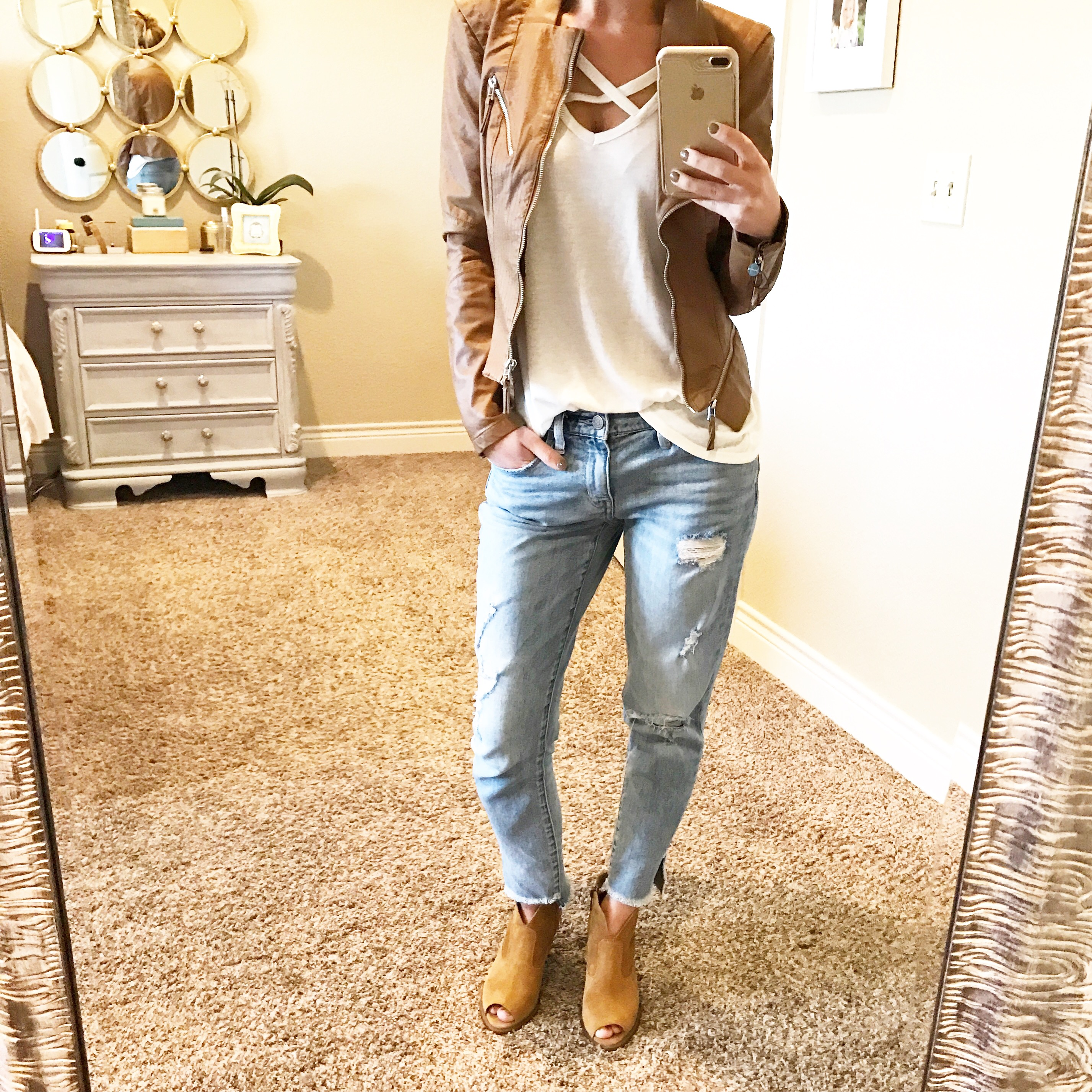 fall outfit inspiration moto jacket ripped jeans and booties