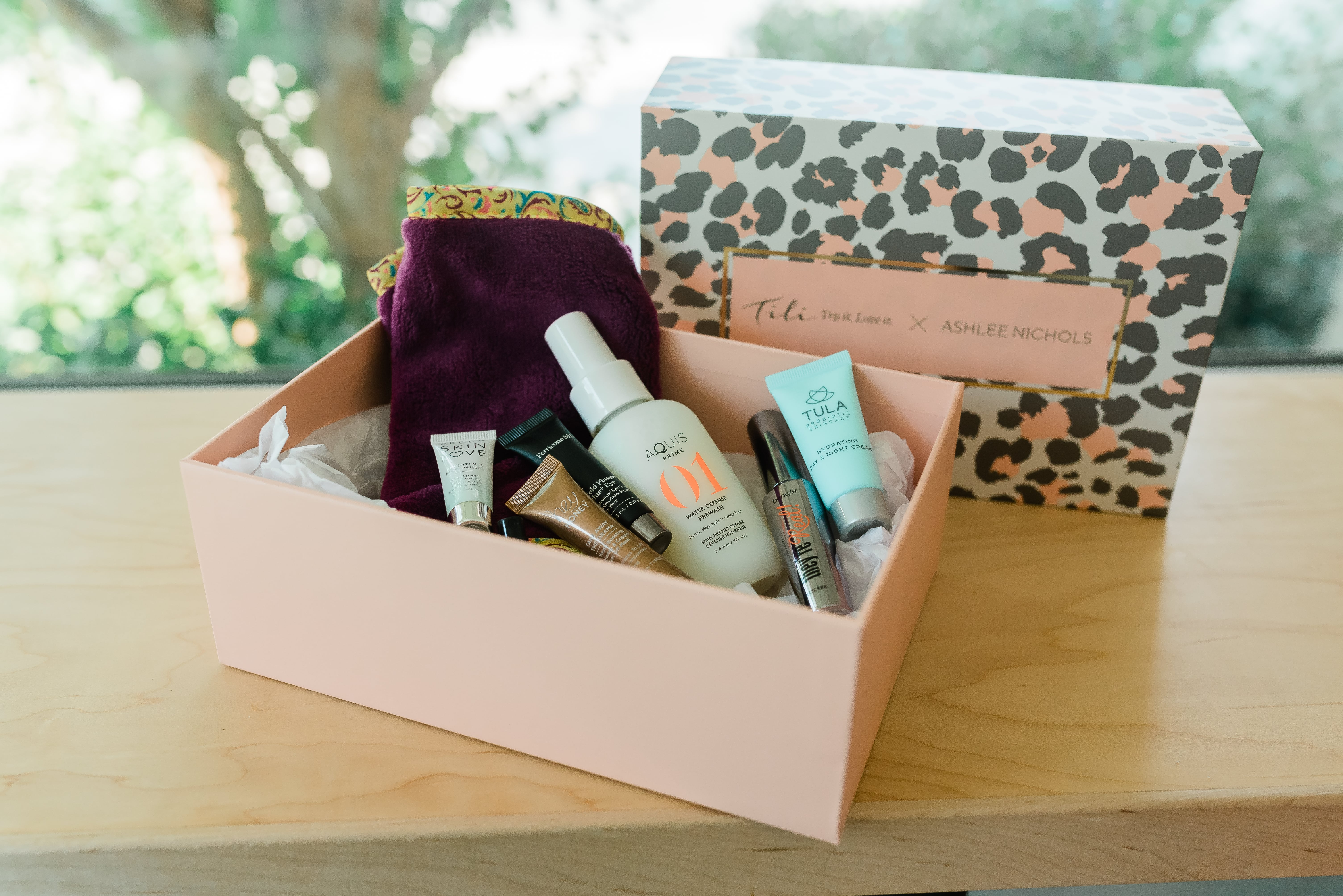 Life & Style blogger Ashlee Nichols from Little Lovelies Blog designs and curates a TILI beauty box with QVC. She features beauty, makeup, and bath items.