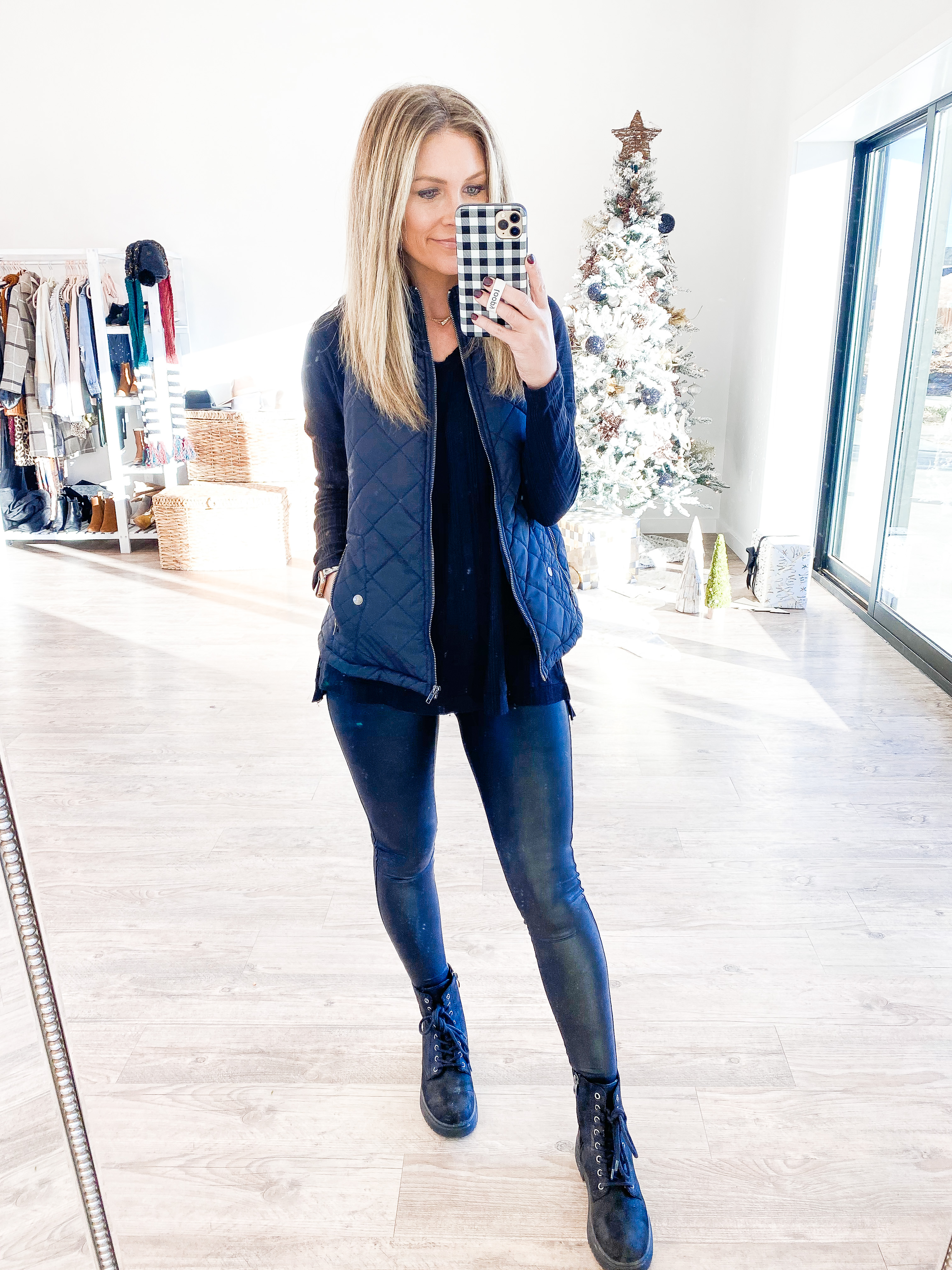 winter vest and sweater with leggings and combat boots
